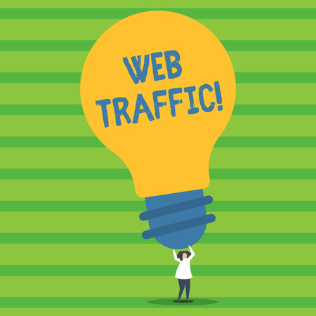 Writing note showing Web Traffic. Business concept for amount of data sent and received by visitors to website Person Standing Arms Holding Big Yellow Lightbulb for Ideas 写真素材 - 119874210