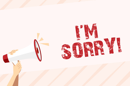 Conceptual hand writing showing I M Sorry. Concept meaning telling someone that you are ashamed or unhappy about something Human Hand Holding Megaphone with Sound Icon and Text Space Stock Photo