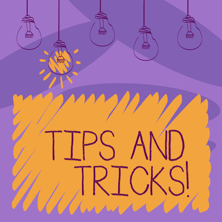 Writing note showing Tips And Tricks. Business concept for means piece advice maybe suggestion how improve Transparent Bulbs Hanging with Filament and One Lighted Icon Stock Photo