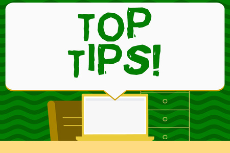 Writing note showing Top Tips. Business concept for small but particularly useful efficient piece of practical advice Speech Bubble Pointing White Laptop Screen in Workspace Idea