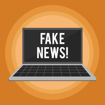 Writing note showing Fake News. Business concept for false stories that appear to spread on internet using other media Laptop with Grid Design Keyboard Screen on Pastel Backdrop 写真素材 - 119910047