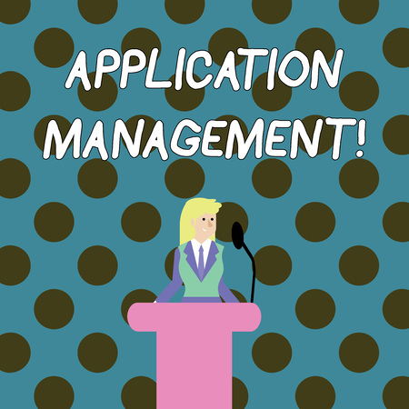 Word writing text Application Management. Business photo showcasing analysisaging applications throughout their lifecycle Businesswoman Standing Behind Podium Rostrum Speaking on Wireless Microphone Foto de archivo