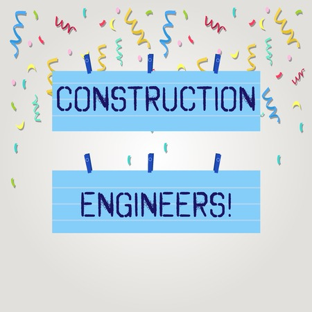 Text sign showing Construction Engineers. Business photo text discipline that deals with designing and planning Two Color Blank Strip Size Lined Paper Sheet Hanging Using Blue Clothespin Standard-Bild