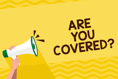 Word writing text Are You Covered Question. Business photo showcasing asking showing if they had insurance in work or life Human Hand Holding Tightly a Megaphone with Sound Icon and Blank Text Space