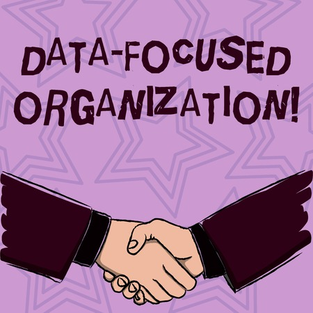 Word writing text Data Focused Organization. Business photo showcasing capture and reinforce value of their informations Businessmen Shaking Hands Firmly as Gesture Form of Greeting and Agreement