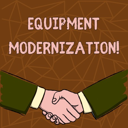 Text sign showing Equipment Modernization. Business photo text changing product service to include new functions Businessmen Shaking Hands Firmly as Gesture Form of Greeting and Agreement Foto de archivo