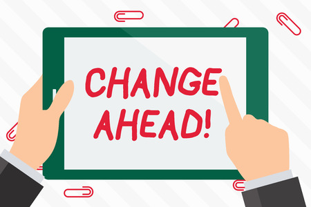 Text sign showing Change Ahead. Business photo showcasing act or process through which something becomes different Hand Holding Pointing Touching Blank Rectangular Color Tablet White Screen Фото со стока