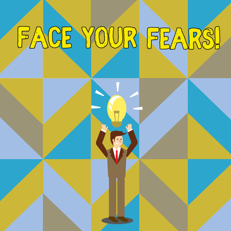 Handwriting text writing Face Your Fears. Conceptual photo recognize you are afraid something and try work through Businessman Standing Raising Arms Upward with Lighted Bulb Icon on his Head