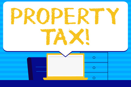 Conceptual hand writing showing Property Tax. Concept meaning bills levied directly on your property by government Blank Huge Speech Bubble Pointing to the White Laptop Screen
