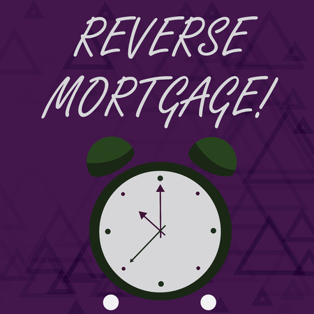 Handwriting text writing Reverse Mortgage. Conceptual photo financial agreement which homeowner relinquishes equity Colorful Round Analog Two Bell Alarm Desk Clock with Seconds Hand photo Stock Photo