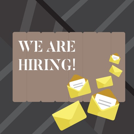Text sign showing We Are Hiring. Business photo showcasing recently employ someone or pay him to do particular job Closed and Open Envelopes with Letter Tucked In on Top of Color Stationery