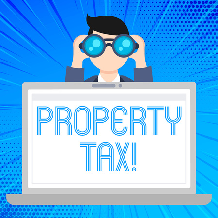 Writing note showing Property Tax. Business concept for bills levied directly on your property by government Man Holding and Looking into Binocular Behind Laptop Screen