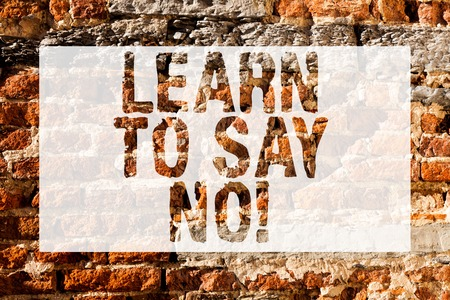 Handwriting text Learn To Say No. Conceptual photo It means that you need to decline or refuse few things Brick Wall art like Graffiti motivational call written on the wall Фото со стока