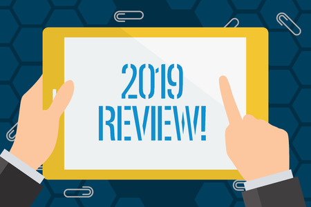Conceptual hand writing showing 2019 Review. Concept meaning remembering past year events main actions or good shows Businessman Hand Holding and Pointing Colorful Tablet Screen