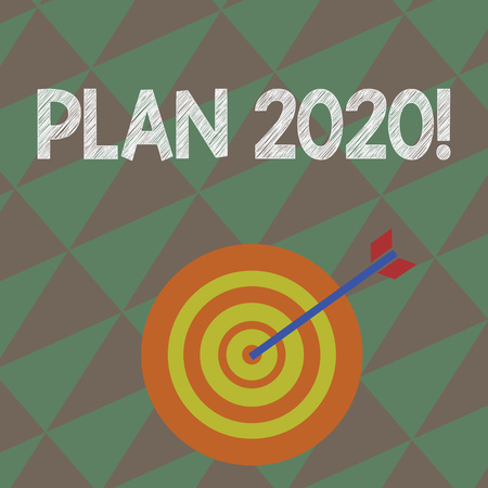 Writing note showing Plan 2020. Business concept for detailed proposal doing achieving something next year Dart Board in Concentric Style with Arrow Hitting the Center Bulls Eye 写真素材