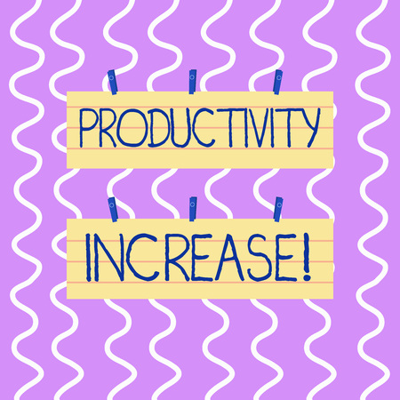 Conceptual hand writing showing Productivity Increase. Concept meaning Labor productivity growth More output from worker Strip Size Lined Paper Sheet Hanging Using Blue Clothespin