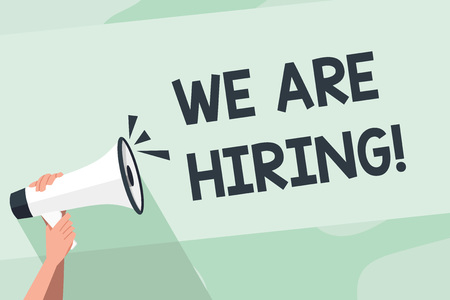 Word writing text We Are Hiring. Business photo showcasing recently you employ someone or pay someone to do particular job Human Hand Holding Tightly a Megaphone with Sound Icon and Blank Text Space