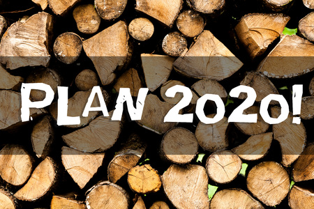 Writing note showing Plan 2020. Business concept for detailed proposal for doing or achieving something next year Wooden background vintage wood wild message ideas intentions thoughts Stock Photo