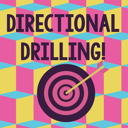 Text sign showing Directional Drilling. Business photo text drilling for oil which the well not drilled vertically Color Dart Board in Concentric Style with Arrow Hitting the Center Bulls Eye 免版税图像