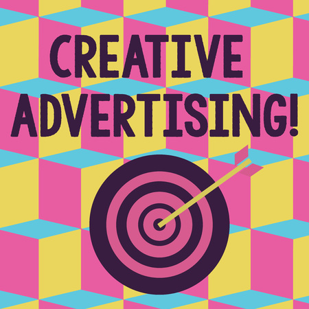 Text sign showing Creative Advertising. Business photo text advertising ideas and brings those ideas into being Color Dart Board in Concentric Style with Arrow Hitting the Center Bulls Eye