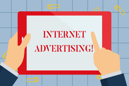 Text sign showing Internet Advertising. Business photo text uses the Internet to deliver promotional marketing Hand Holding Pointing Touching Blank Rectangular Color Tablet White Screen