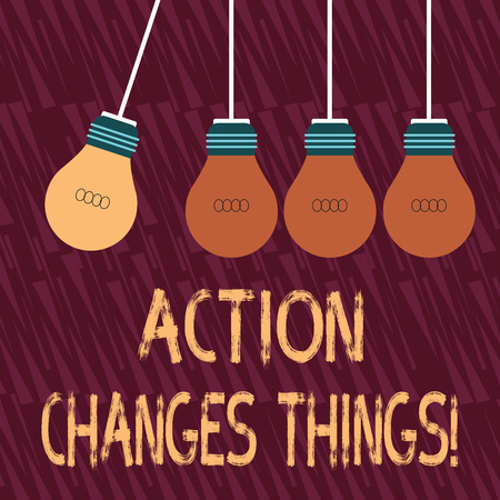 Text sign showing Action Changes Things. Business photo text start doing something against problem resolve or achieve it Color Incandescent Pendant Bulb Hanging with One Different Shade Lightbulb Reklamní fotografie