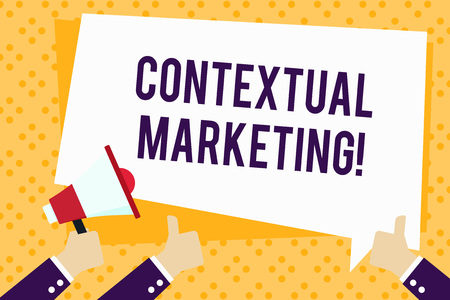 Writing note showing Contextual Marketing. Business concept for online and mobile marketing Behavioural targeting Hand Holding Megaphone and Gesturing Thumbs Up Text Balloon Stock Photo
