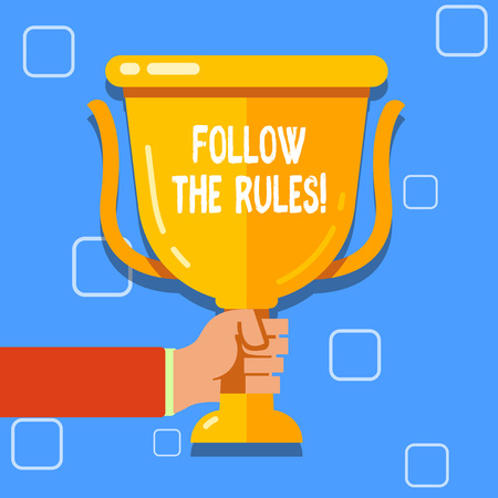 Writing note showing Follow The Rules. Business concept for go with regulations governing conduct or procedure Hand Holding Championship Winners Cup Trophy with Reflection
