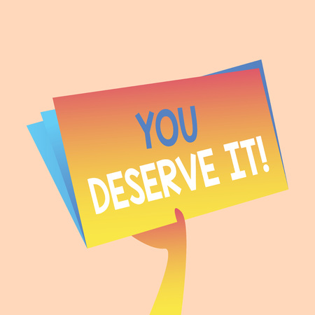 Handwriting text writing You Deserve It. Conceptual photo should have it because of their qualities or actions Hand Holding and Raising Blank Space Colorful File Folder with Sheet Inside