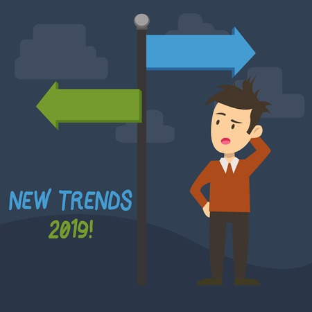 Text sign showing New Trends 2019. Business photo showcasing general direction in which something is developing Man Confused with the Road Sign Arrow Pointing to Opposite Side Direction