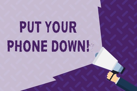 Text sign showing Put Your Phone Down. Business photo showcasing end telephone connection saying goodbye caller Hand Holding Megaphone with Blank Wide Beam for Extending the Volume Range