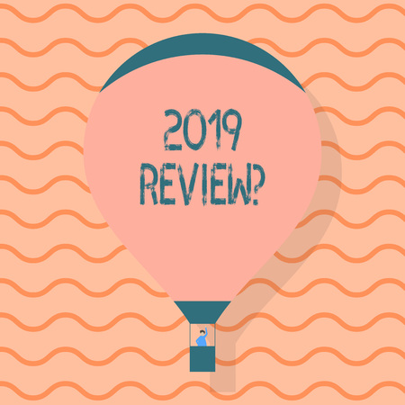 Conceptual hand writing showing 2019 Review Question. Concept meaning remembering past year events main actions or good shows Hot Air Balloon Floating with Passenger Waving From Gondola