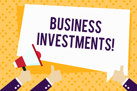 Writing note showing Business Investments. Business concept for act of committing money or capital to an endeavor Hand Holding Megaphone and Gesturing Thumbs Up Text Balloon