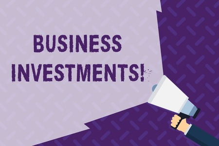 Text sign showing Business Investments. Business photo showcasing act of committing money or capital to an endeavor Hand Holding Megaphone with Blank Wide Beam for Extending the Volume Range