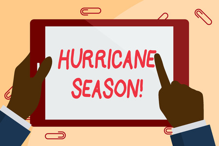Writing note showing Hurricane Season. Business concept for time when most tropical cyclones are expected to develop Businessman Hand Holding and Pointing Colorful Tablet Screen