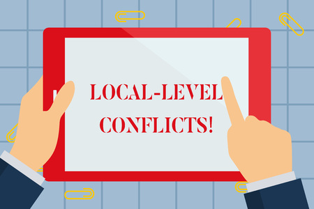 Text sign showing Local Level Conflicts. Business photo text creating local incentives to spoil the process Hand Holding Pointing Touching Blank Rectangular Color Tablet White Screen