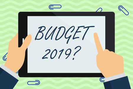 Writing note showing Budget 2019 Question. Business concept for estimate of income and expenditure for next year Businessman Hand Holding and Pointing Colorful Tablet Screen