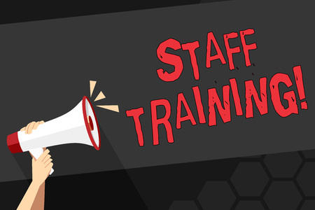 Text sign showing Staff Training. Business photo showcasing program helps employees learn specific knowledge or skills Human Hand Holding Tightly a Megaphone with Sound Icon and Blank Text Space