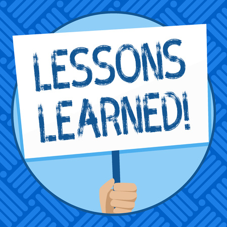 Text sign showing Lessons Learned. Business photo text learning gained from process of performing project Hand Holding Blank White Placard Supported by Handle for Social Awareness