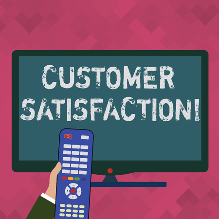 Word writing text Customer Satisfaction. Business photo showcasing Measure of customers fulfillment from a firm Hand Holding Computer Remote Control infront of Blank Wide Color PC Screen