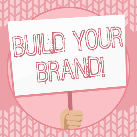 Writing note showing Build Your Brand. Business concept for creates or improves customers knowledge and opinions of product Hand Holding White Placard Supported for Social Awareness