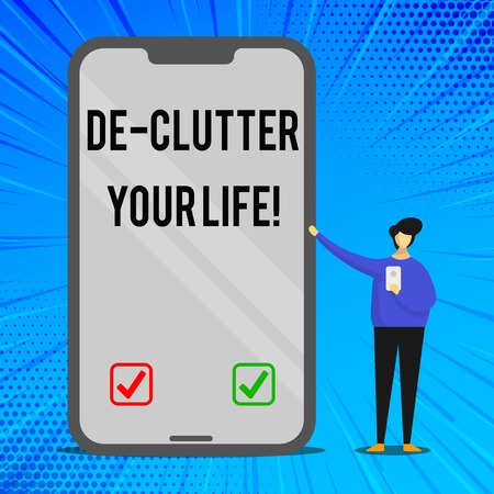 Handwriting text writing De Clutter Your Life. Conceptual photo remove unnecessary items from untidy or overcrowded places Man Presenting Huge Blank Screen Smartphone while Holding Another Mobile