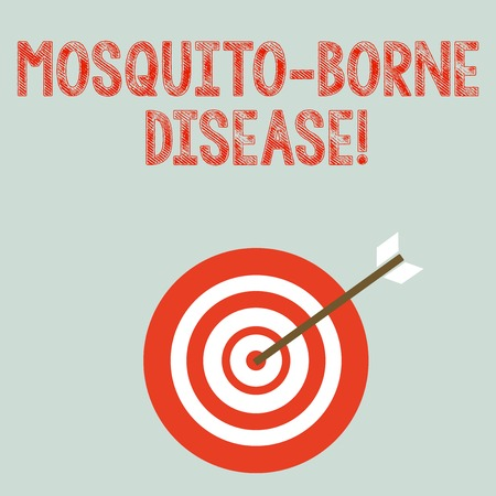 Writing note showing Mosquito Borne Disease. Business concept for illnesses caused parasites transmitted by mosquitoes Dart Board in Concentric Style with Arrow Hitting the Center Bulls Eye 免版税图像