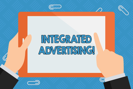 Conceptual hand writing showing Integrated Advertising. Concept meaning Unified experience to consumer to interact with brand Businessman Hand Holding and Pointing Colorful Tablet Screen Stok Fotoğraf
