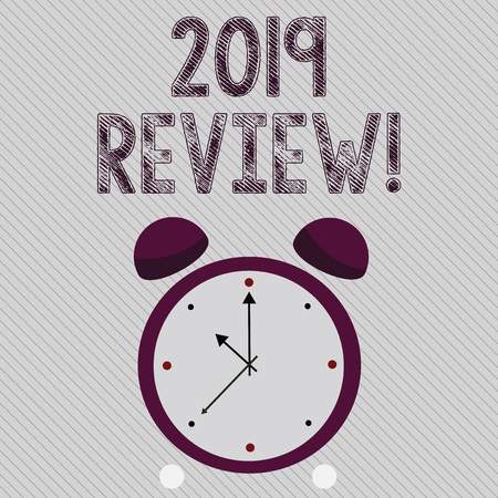 Writing note showing 2019 Review. Business concept for remembering past year events main actions or good shows Colorful Round Analog Two Bell Alarm Desk Clock with Seconds Hand photo