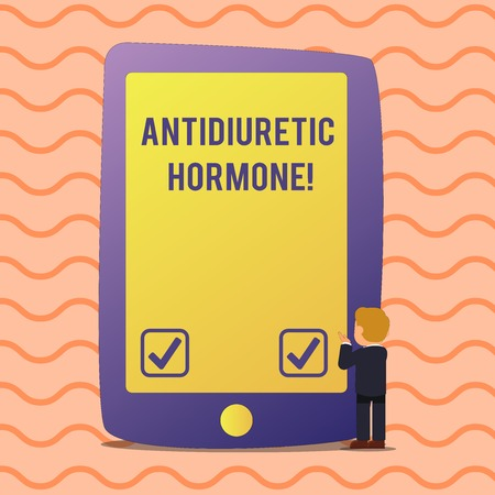 Conceptual hand writing showing Antidiuretic Hormone. Concept meaning peptide molecule that is release by the pituitary gland Businessman Standing and Gesturing on Screen Tablet Device