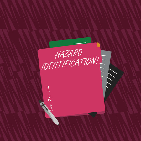 Text sign showing Hazard Identification. Business photo text process used to identify hazards in the workplace Colorful Lined Paper Stationery Partly into View from Pastel Blank Folder 免版税图像