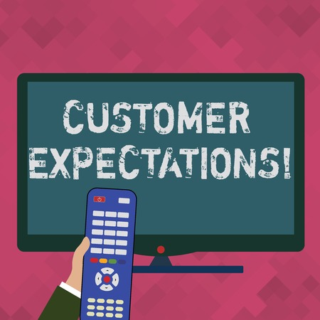 Word writing text Customer Expectations. Business photo showcasing Perceivedvalue clients seek from the buying of a good Hand Holding Computer Remote Control infront of Blank Wide Color PC Screen