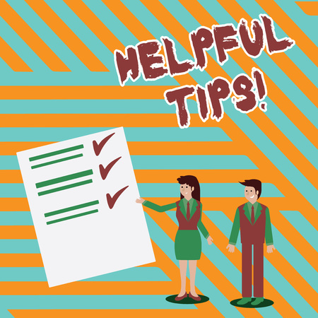 Writing note showing Helpful Tips. Business concept for advices given to be helpful knowledge in life Man and Woman Presenting Report of Check and Lines on Paper Фото со стока
