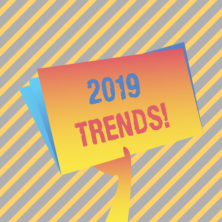 Writing note showing 2019 Trends. Business concept for general direction in which something is developing or changing Hand Holding Blank Space Color File Folder with Sheet Inside